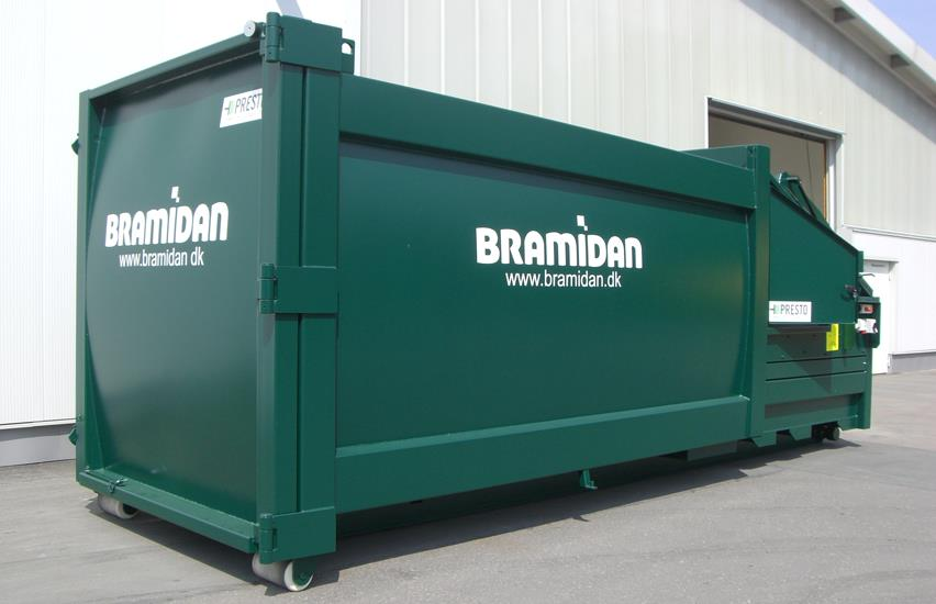 Green Bramidan comtactor placed outside next to grey and white building