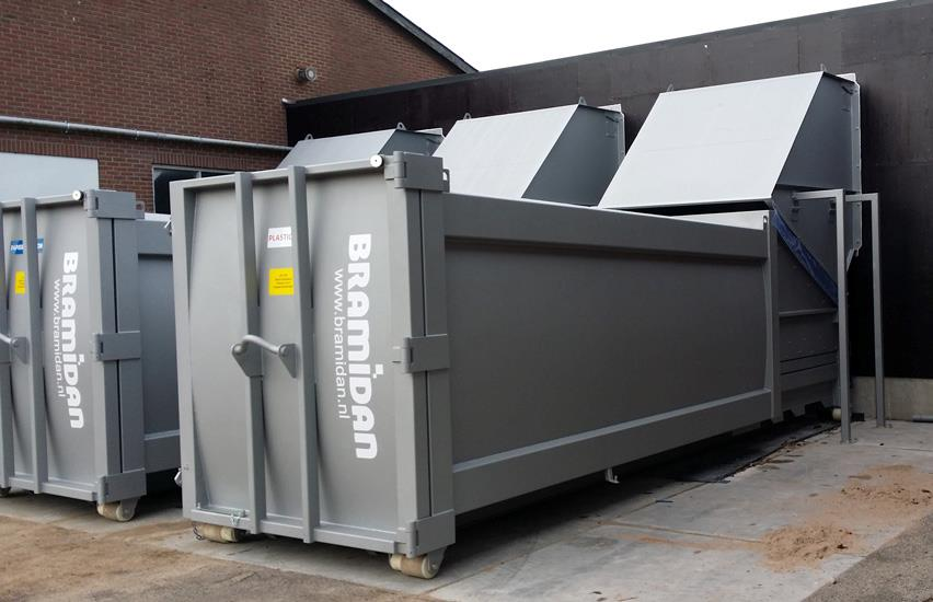 Two grey Bramidan compactor with wallmounted hopper