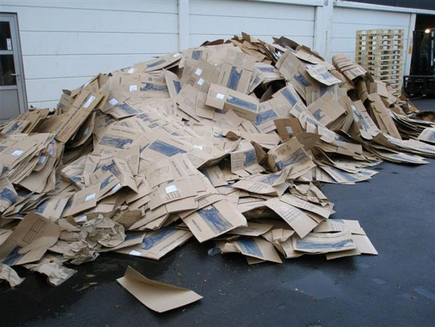 A large pile of cardboard waste outside at Beck Pack