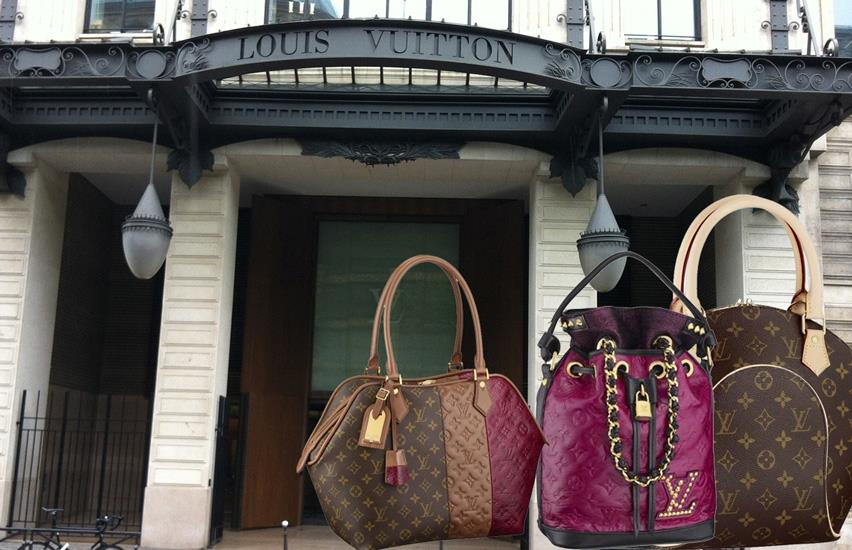 Three Louis Vuitton ladies' bags shown in front of the main building's white columns