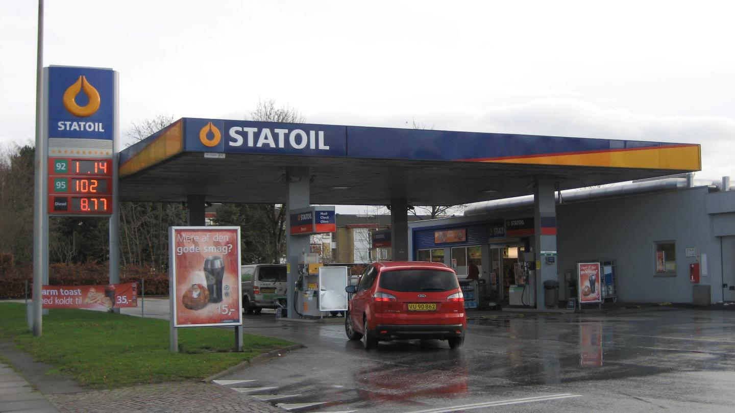 Red yellow-plated car drives into Statoil petrol station
