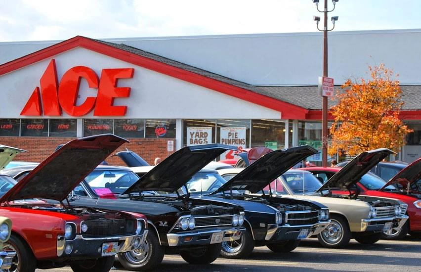 Cars with hood open in front of Olsons Ace Hardware store