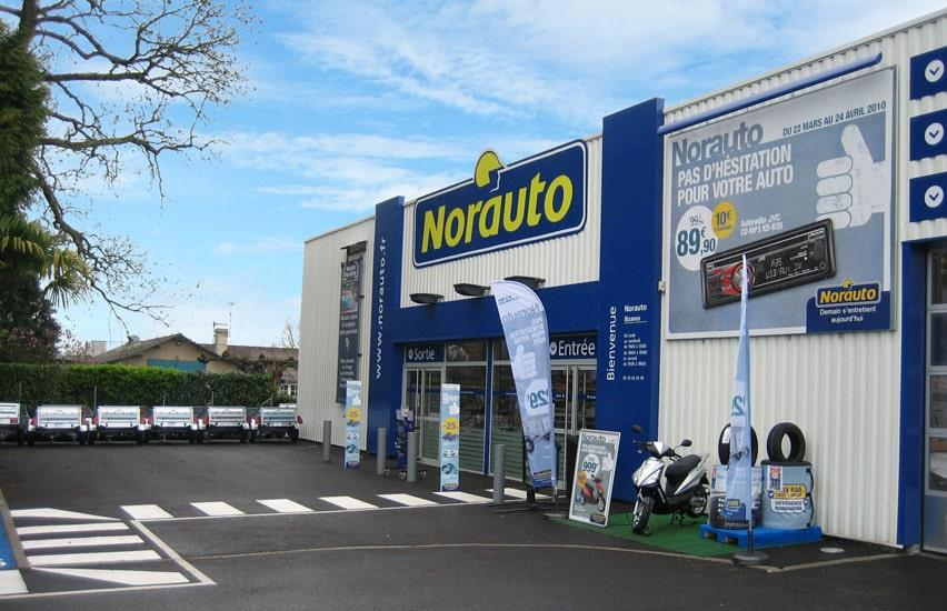 Sign in front of entrance to Norauto garage in France