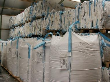 Big bags compacted into bales and stacked on pallets